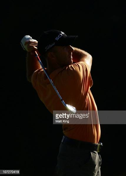 Geoff Ogilvy of Australia plays a fairway shot on the 14th hole during day two of the Australia Open at The Lakes Golf Club on December 3 2010 in...