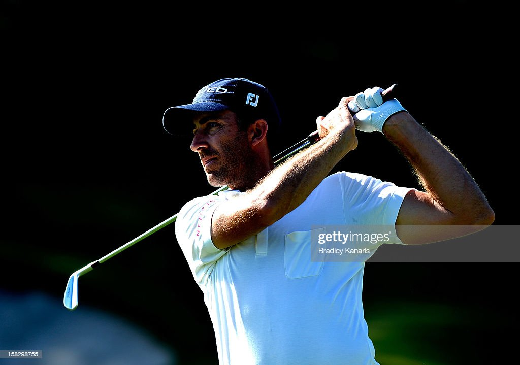 Geoff Ogilvy of Australia plays a shot on the 15th hole during round one of the Australian PGA at the Palmer Coolum Resort on December 13, 2012 in Sunshine Coast, Australia.