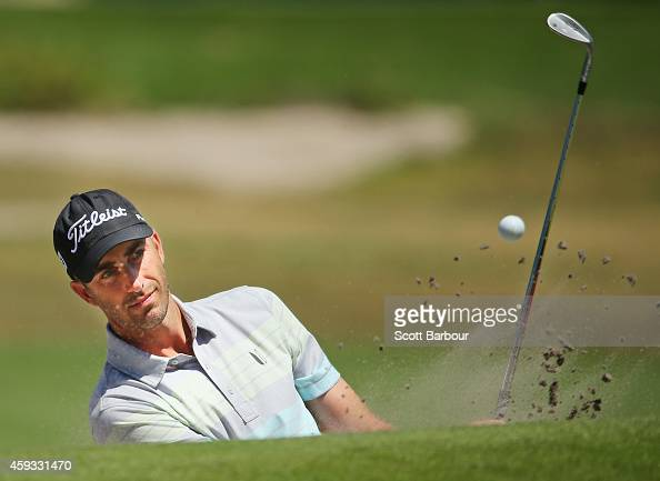 Geoff Ogilvy of Australia plays a shot out of a bunker on the 7th hole during day two of the Australian Masters at The Metropolitan Golf Course on...