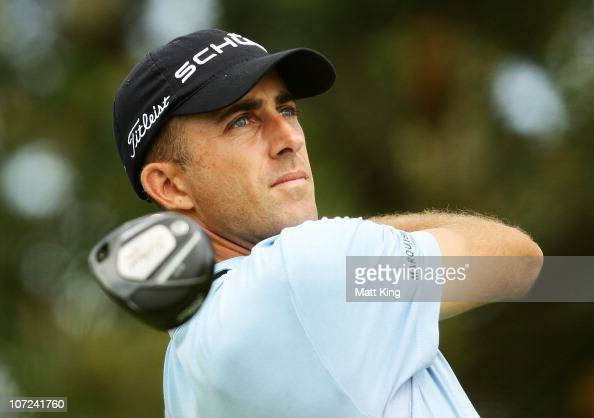 Geoff Ogilvy of Australia plays a tee shot during day one of the Australian Open at The Lakes Golf Club on December 2 2010 in Sydney Australia