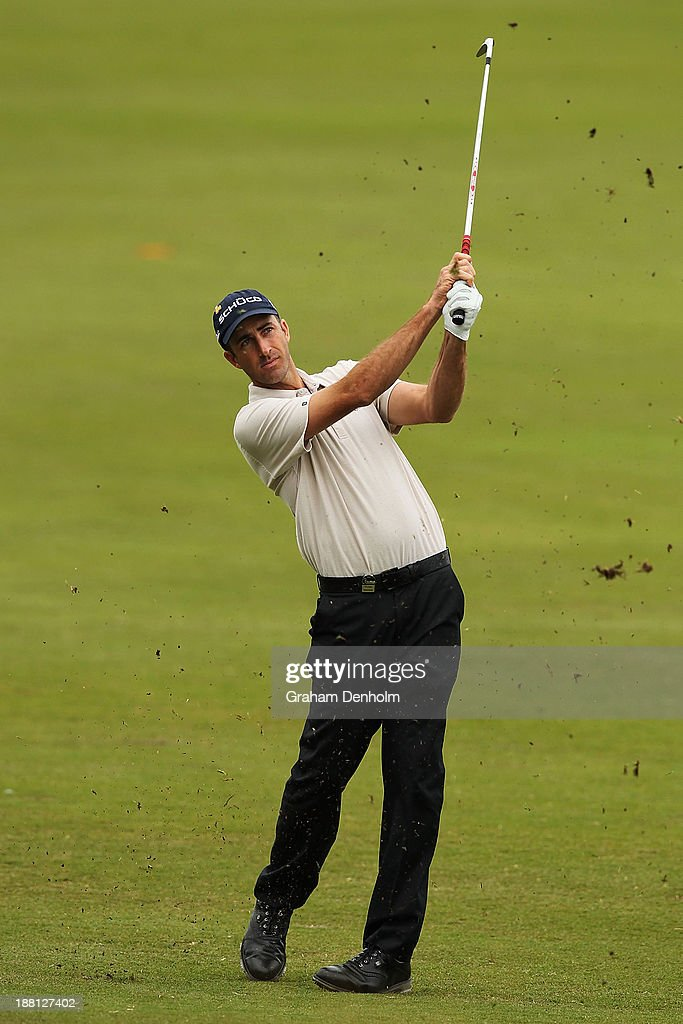 <a gi-track='captionPersonalityLinkClicked' href=/galleries/search?phrase=Geoff+Ogilvy&family=editorial&specificpeople=224652 ng-click='$event.stopPropagation()'>Geoff Ogilvy</a> of Australia plays an approach shot during round three of the 2013 Australian Masters at Royal Melbourne Golf Course on November 16, 2013 in Melbourne, Australia.