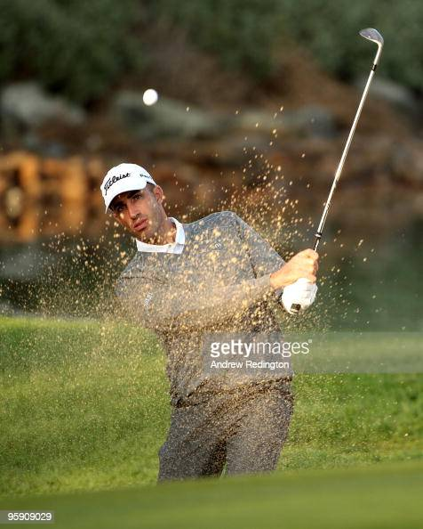 Geoff Ogilvy of Australia plays from a bunker on the 12th hole during the first round of The Abu Dhabi Golf Championship at Abu Dhabi Golf Club on...