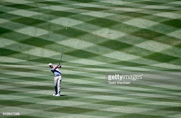 Geoff Ogilvy of Australia plays his shot on the first fairway during the first round of the Barracuda Championship at the Montreux Golf and Country...