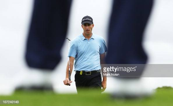 Geoff Ogilvy of Australia prepares to putt on the sixth hole during day one of the Australian Open at The Lakes Golf Club on December 2 2010 in...