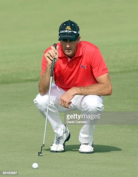 Geoff Ogilvy of Australia putts at the 8th hole during the final round of the Dubai World Championship on the Earth Course Jumeirah Golf Estates on...