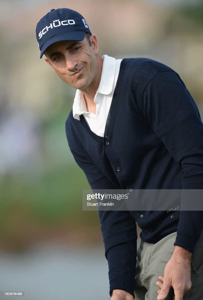 Geoff Ogilvy of Australia reacts to his putt on the 14th hole during the third round of the Honda Classic on March 2, 2013 in Palm Beach Gardens, Florida.