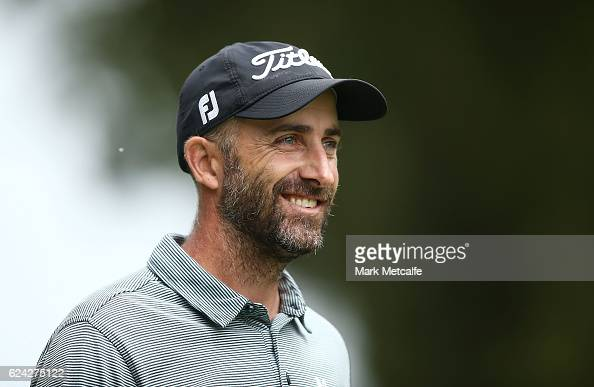 Geoff Ogilvy of Australia smiles after hitting his approach shot on the 18th hole during day three of the Australian golf Open at Royal Sydney GC at...