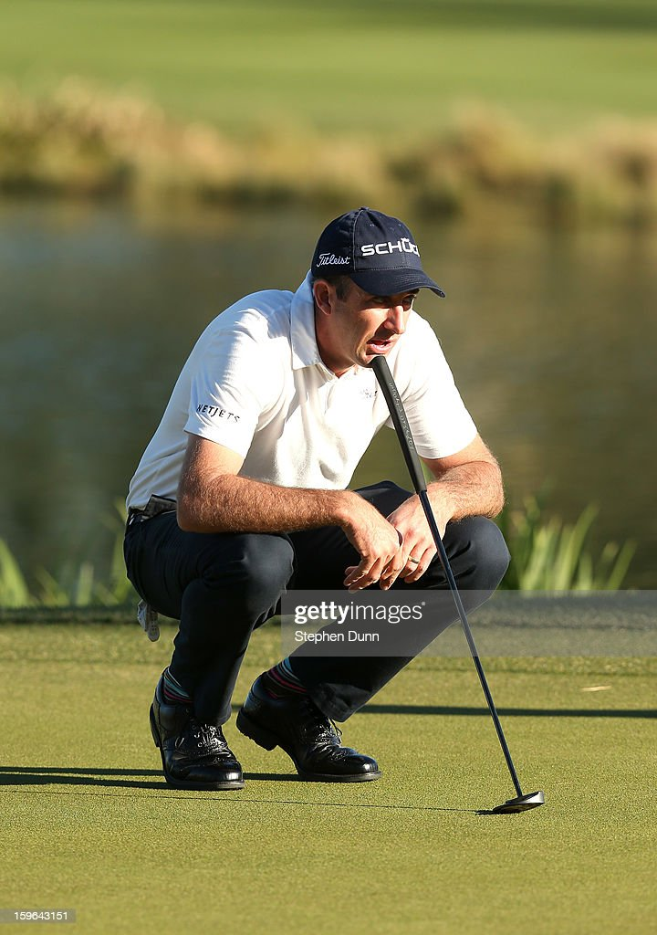 Geoff Ogilvy of Australia surveys the 18th green during the first round of the Humana Challenge in partnership with the Clinton Foundation at La Quinta Country Club on January 17, 2013 in La Quinta, California.