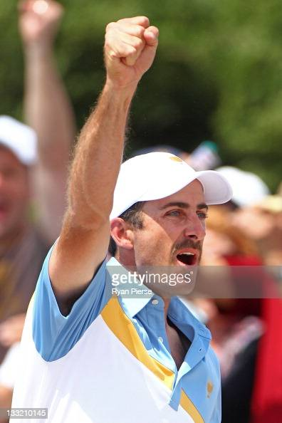 Geoff Ogilvy of the International Team celebrates holing in his second shot from a bunker on the fifth hole during the Day Two FourBall Matches of...