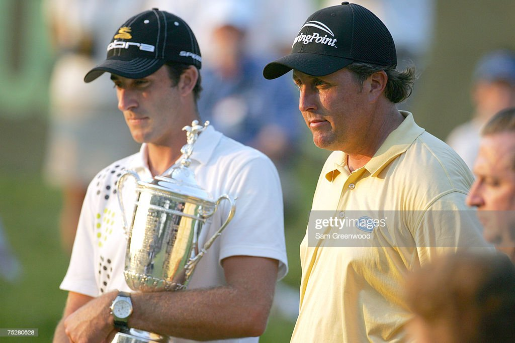 Geoff Ogilvy poses with Phil Mickelson and the trophy after winning the 2006 US Open Championship at Winged Foot Golf Club in Mamaroneck New York on...