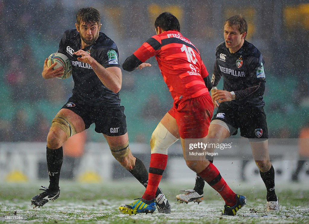 Geoff Parling and Mathew Tait of Leicester take on Lionel Beauxis of Toulouse during the Heineken Cup match between Leicester Tigers and Toulouse at Welford Road on January 20, 2013 in Leicester, England.