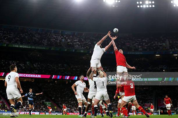 Geoff Parling of England and Bradley Davies of Wales compete for lineout ball during the 2015 Rugby World Cup Pool A match between England and Wales...