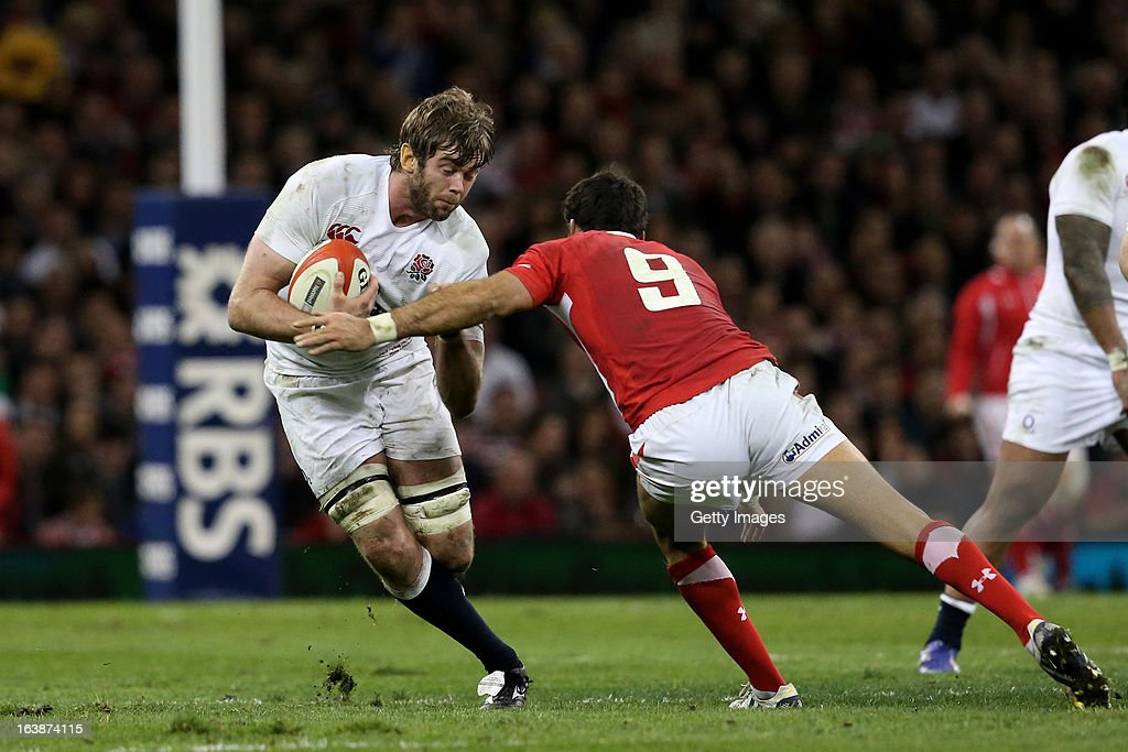 <a gi-track='captionPersonalityLinkClicked' href=/galleries/search?phrase=Geoff+Parling&family=editorial&specificpeople=820816 ng-click='$event.stopPropagation()'>Geoff Parling</a> of England is tackled by Mike Phillips of wales during the RBS Six Nations match between Wales and England at Millennium Stadium on March 16, 2013 in Cardiff, Wales.