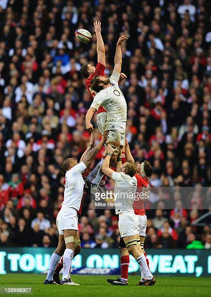 Geoff Parling of England jumps for the lineout ball with Ian Evans of Wales during the RBS 6 Nations match between England and Wales at Twickenham...