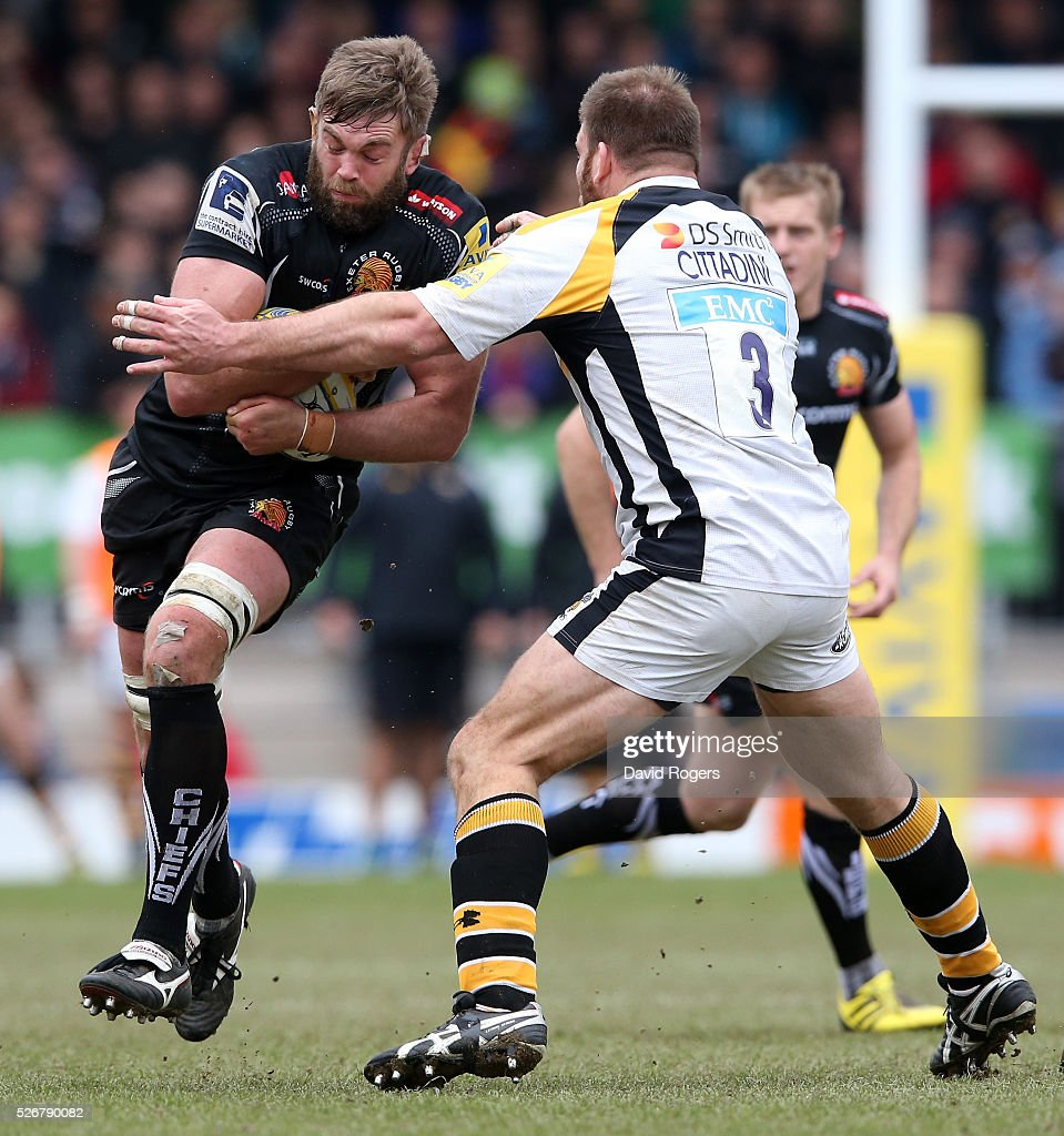 Geoff Parling of Exeter is tackled by Lorenzo Cittadini during the Aviva Premiership match between Exeter Chiefs and Wasps at Sandy Park on May 1, 2016 in Exeter, England.
