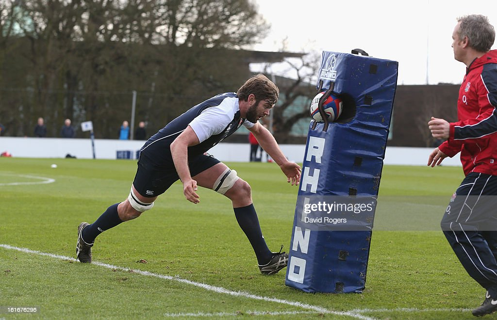 Geoff Parling pratices his tackling during the England training session held at St Georges Park on February 14, 2013 in Burton-upon-Trent, England.