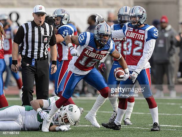 Geoff Tisdale of the Montreal Alouettes celebrates after intercepting the ball during the CFL game against the Saskatchewan Roughriders at Percival...
