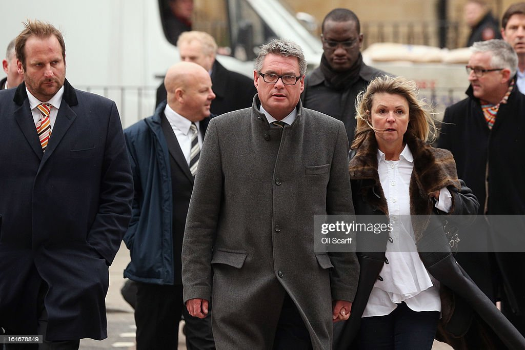 Geoff Webster (C), the deputy editor of the Sun newspaper, arrives at Westminster Magistrates Court with his wife Alison Webster (2nd R) and reporters from the newspaper on March 26, 2013 in London, England. Mr Webster has been charged with allegedly authorising two payments, totaling 8,000 GBP, to public officials for information.