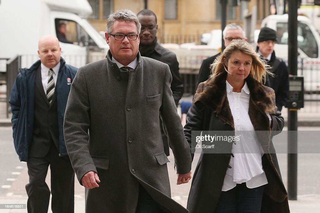 Geoff Webster (C), the deputy editor of the Sun newspaper, arrives at Westminster Magistrates Court with his wife Alison Webster and reporters from the newspaper on March 26, 2013 in London, England. Mr Webster has been charged with allegedly authorising two payments, totaling 8,000 GBP, to public officials for information.