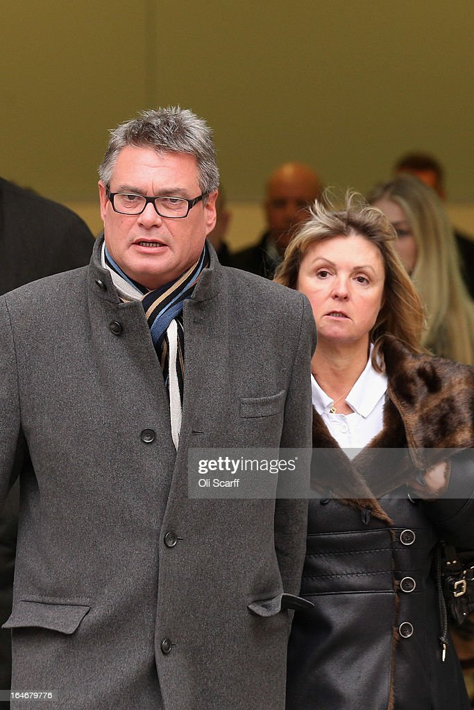Geoff Webster, the deputy editor of the Sun newspaper, leaves Westminster Magistrates Court with his wife Alison Webster on March 26, 2013 in London, England. Mr Webster has been charged with allegedly authorising two payments, totaling 8,000 GBP, to public officials for information.