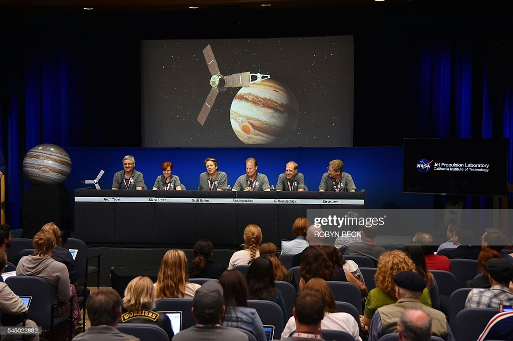 Geoff Yoder, acting administrator for NASA's Science Mission Directorate, Diane Brown, NASA Juno program executive, Scott Bolton, Juno principal investigator, Juno Project manager Rick Nybakken, Guy Beutelschies, Lockheed Martin director of space exploration and Steve Levin, Juno Project scientist, attend a press conference after the Juno spacecraft was successfully placed into Jupiter's orbit, at the Jet Propulsion Laboratory in Pasadena, California on July 4, 2016. Juno was launched from Cape Canaveral in Florida on August 5, 2011 on a five-year voyage to its mission to study the planet's formation, evolution and structure. / AFP / Robyn BECK