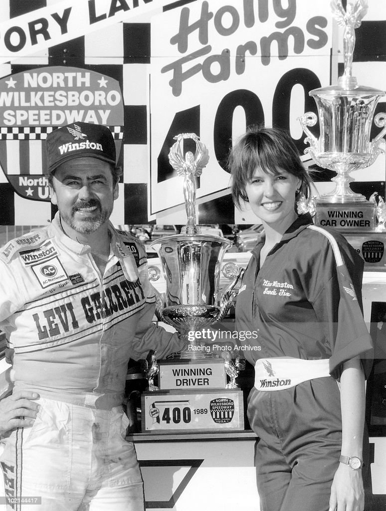 Geoffery Bodine (L) celebrates in Victory Lane after winning the Holly Farms 400 October 15, 1989 in North Wilkesboro, North Carolina. Bodine would lead for 1 lap and take home $47,800 for the race.