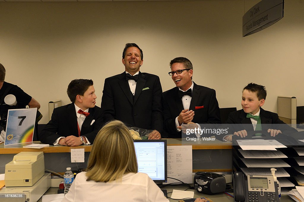 Geoffrey Bateman, second from left, and Mark Thurn are joined by the children, Zian Lusero, left, and his brother Eliot while applying for their civil union license at the Webb Building in Denver CO, May 01, 2013. The Clerk and Recorder's Office opened for business from midnight to 3 a.m. to issue civil union licenses to couples on May 01, 2013 when the Civil Union Act became law. One Colorado offered a civil-union celebration for couples in the building's atrium from midnight to 2 a.m., as judges, magistrates and other officiants performed the ceremonies. Colorado became the latest state to recognize the legal rights of same-sex couples — through marriage or civil unions — when Gov. John Hickenlooper signed state Senate Bill 11 into law March 21.