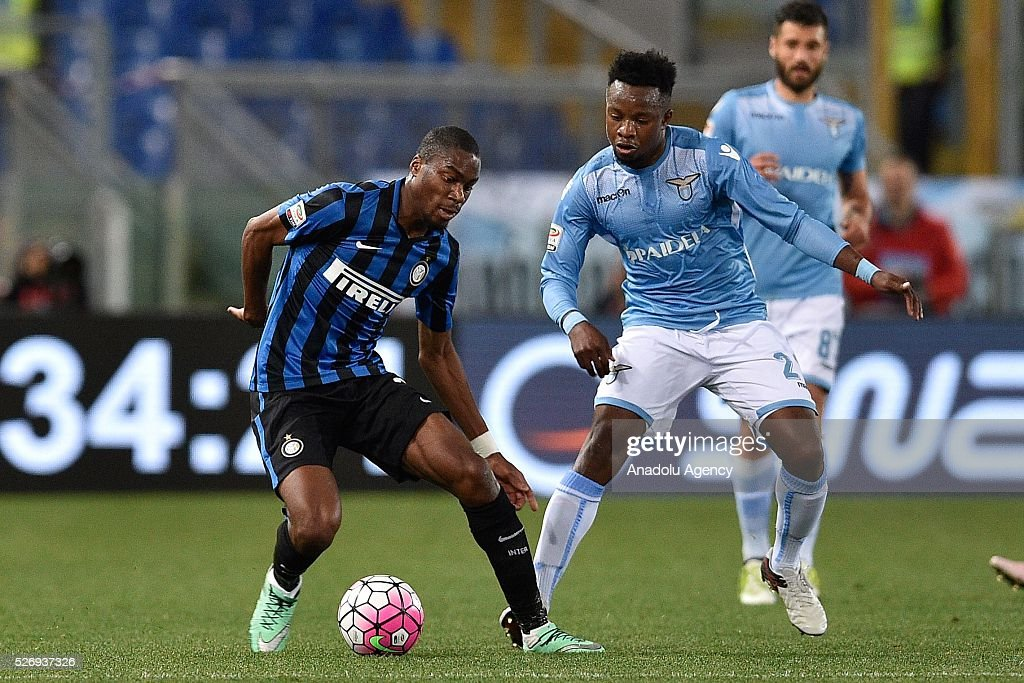 Geoffrey Condogbia (L) of FC Inter competes with Eddy Onazi (R) of SS Lazio during the Serie A match between SS Lazio and FC Internazionale Milano at Stadio Olimpico on May 1, 2016 in Rome, Italy.
