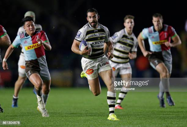 Geoffrey Doumayrou of La Rochelle runs in to score a tryduring the European Rugby Champions Cup match between Harlequins and La Rochelle at...
