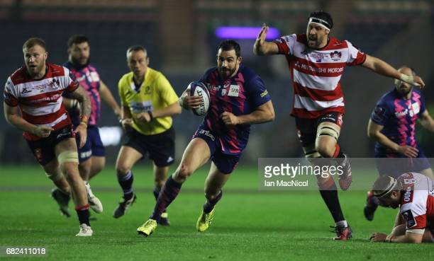 Geoffrey Doumayrou of Stade Francais breaks through the Gloucester defence to score his team's third try during the European Rugby Challenge Cup...