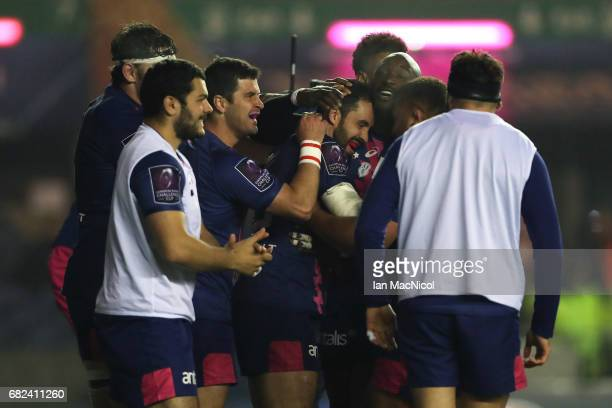 Geoffrey Doumayrou of Stade Francais is congratulated by teammates after scoring his team's third try during the European Rugby Challenge Cup Final...