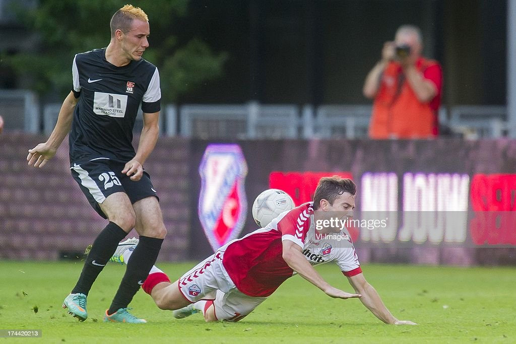 Geoffrey Franzoni of FC Differdange 03, Tommy Oar of FC Utrecht during the Europa League second qualifying round match between FC Utrecht and FC Differdange on July 25, 2013 in Utrecht, The Netherlands.