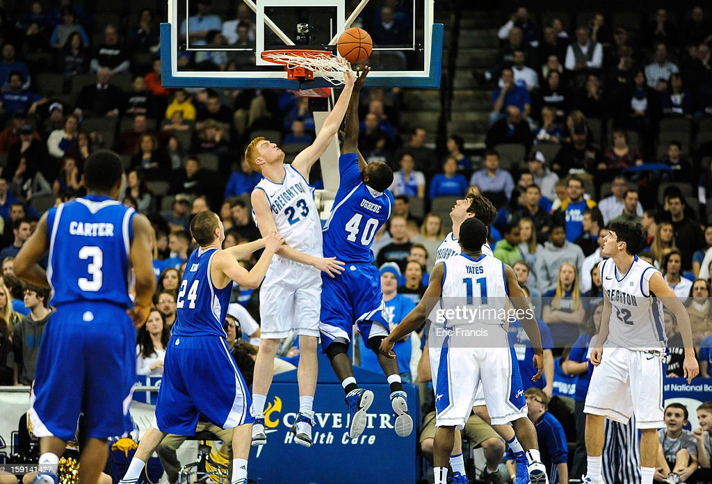 Geoffrey Groselle #23 of the Creighton Bluejays tries to block the shot of Daddy Ugbede #40 of the Drake Bulldogs during their game at the CenturyLink Center on January 8, 2013 in Omaha, Nebraska. Creighton defeated Drake 91-61.