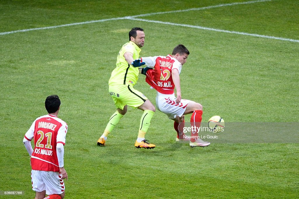 Geoffrey Jourdren of Montpellier and Nicolas De Preville of Reims during the French Ligue 1 match between Stade de Reims and Montpellier Herault SC at Stade Auguste Delaune on April 30, 2016 in Reims, France.