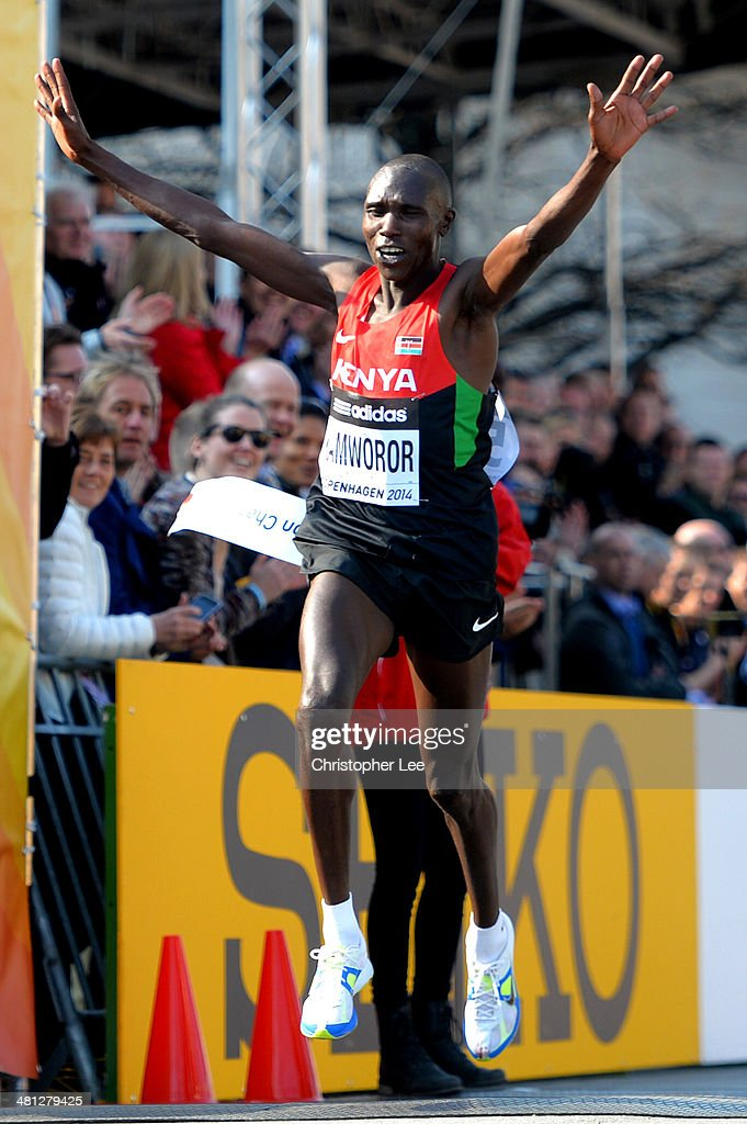 Geoffrey Kamworor of Kenya celebrates victory as he crosses the finish line in first place during the IAAF/Al-Bank World Half Marathon Championships on March 29, 2014 in Copenhagen, Denmark.