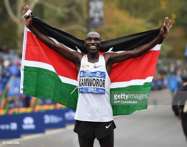 Geoffrey Kamworor of Kenya holds up his national flag as he celebrates winning the Men's Division during the 2017 TCS New York City Marathon in New...