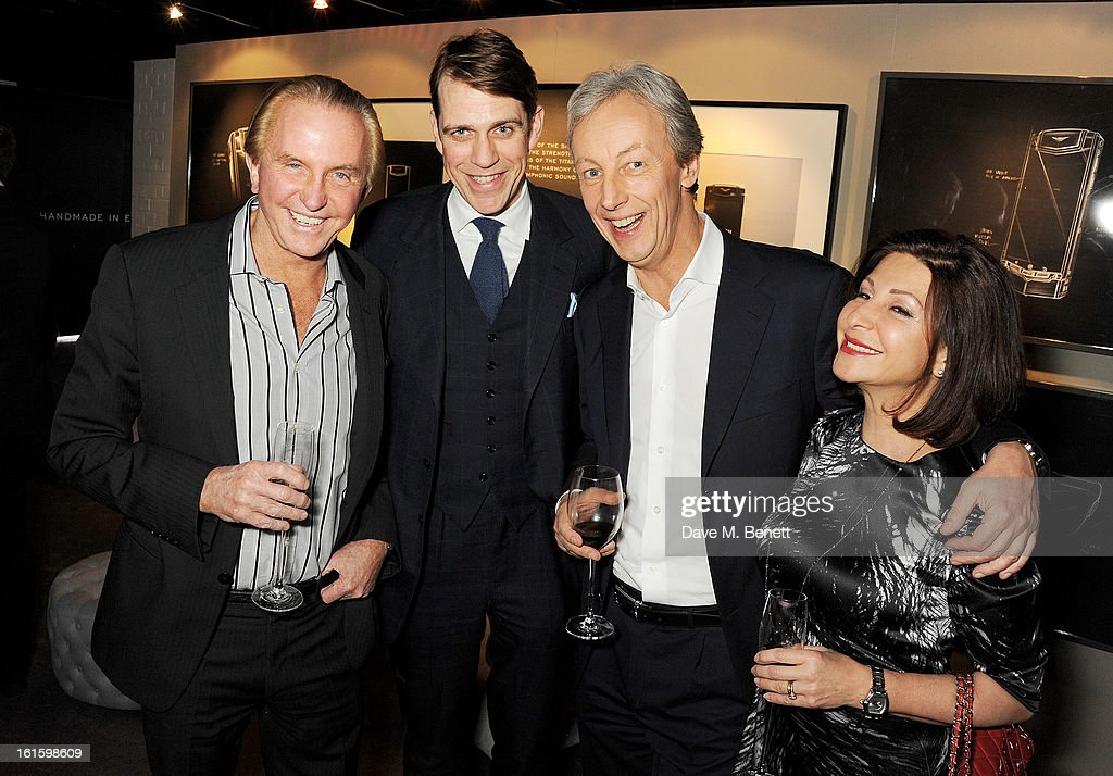 Geoffrey Kent, Ben Elliot, Vertu CEO Perry Oosting and wife Yelena attend the launch of the Vertu Ti at the London Film Museum, Covent Garden on February 12, 2013 in London, England.