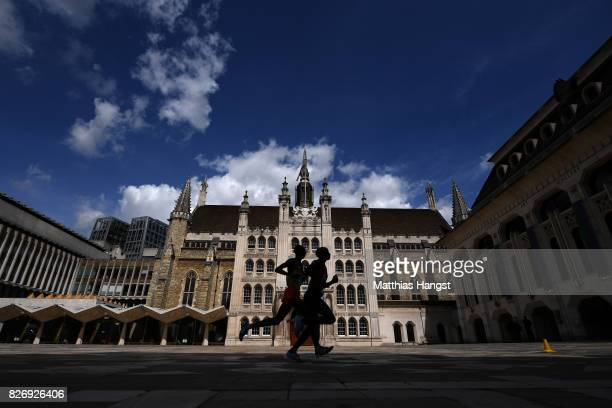 Geoffrey Kipkorir Kirui of Kenya and Tamirat Tola of Ethiopia pass the Guildhall in the Men's Marathon in the Men's Marathon during day three of the...