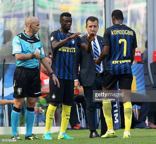 Geoffrey Kondogbia and Assan Gnoukouri of Inter competes for the ball with Simone Verdi of Bologna during the Serie A match between FC Internazionale...