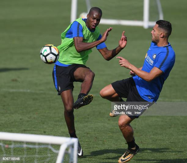 Geoffrey Kondogbia and Danilo D'Ambrosio of FC Internazionale compete for the ball during a training session at Suning Training Center at Appiano...