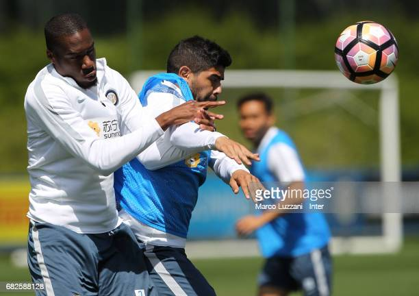 Geoffrey Kondogbia competes with Ever Banega during the FC Internazionale training session at the club's training ground Suning Training Center in...