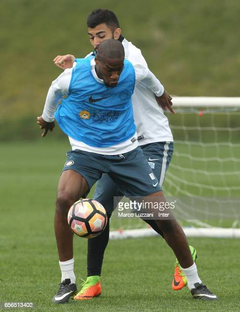 Geoffrey Kondogbia competes with Gabriel Barbosa Gabigol during the FC Internazionale training session at the club's training ground Suning Training...