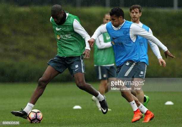 Geoffrey Kondogbia competes with Jeison Murillo during the FC Internazionale training session at the club's training ground Suning Training Center in...