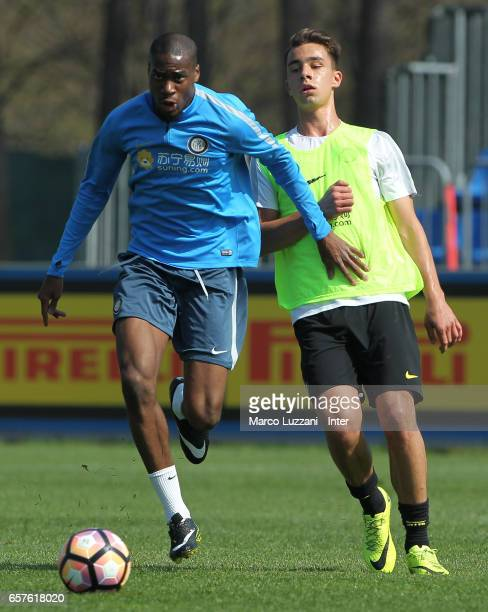 Geoffrey Kondogbia is challenged during the FC Internazionale training session at the club's training ground Suning Training Center in memory of...