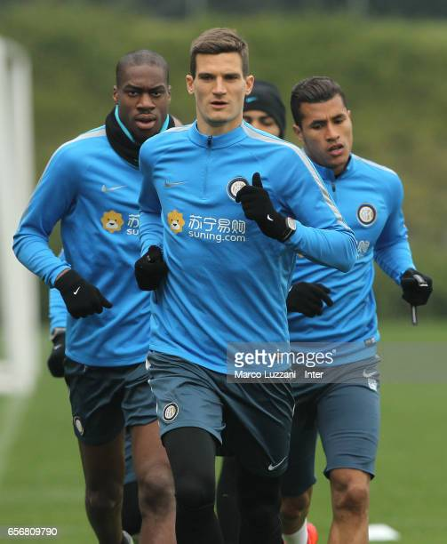 Geoffrey Kondogbia Marco Andreolli and Jeison Murillo run during the FC Internazionale training session at the club's training ground Suning Training...