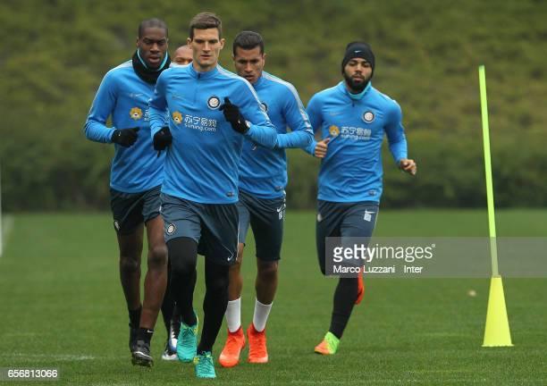 Geoffrey Kondogbia Marco Andreolli Jeison Murillo and Gabriel Barbosa Gabigol run during the FC Internazionale training session at the club's...