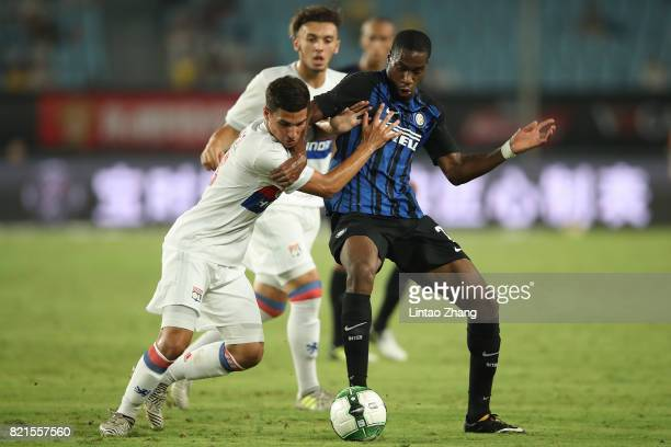 Geoffrey Kondogbia of FC Internationale competes for the ball with Houssem Aouar of Olympique Lyonnais during the 2017 International Champions Cup...