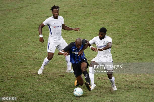 Geoffrey Kondogbia of FC Internazionale and Jeremy Boga of Chelsea FC challenge for the ball during the International Champions Cup match between FC...