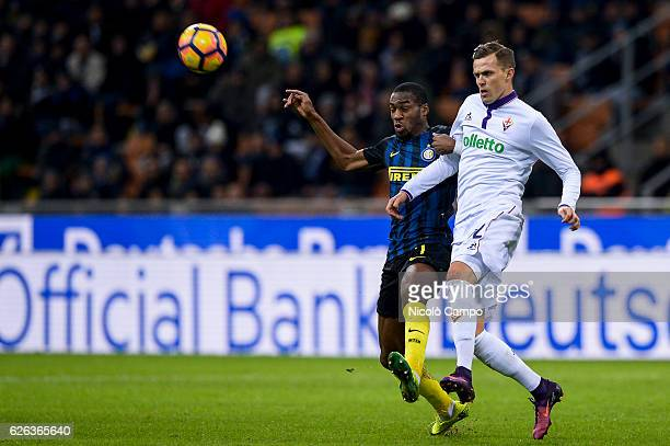 Geoffrey Kondogbia of FC Internazionale and Josip Ilicic of ACF Fiorentina compete for the ball during the Serie A football match between FC...