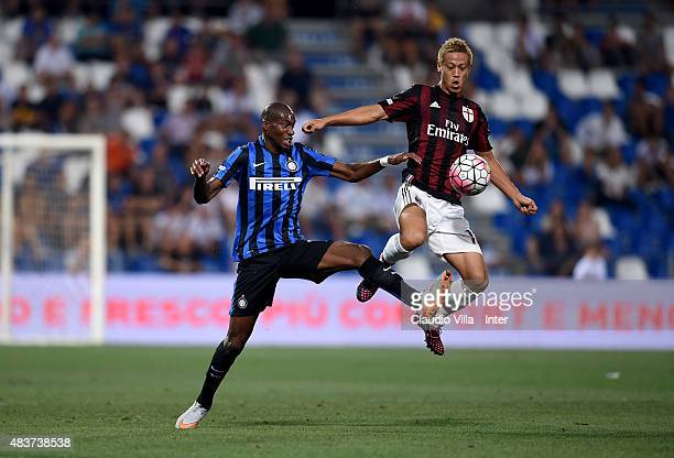 Geoffrey Kondogbia of FC Internazionale and Keisuke Honda of AC Milan compete for the ball during the TIM preseason tournament match between FC...
